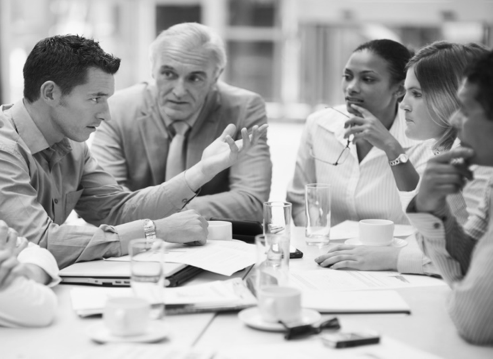 Business people conduct a meeting