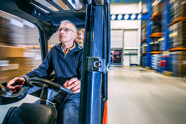 A man drives a forklift